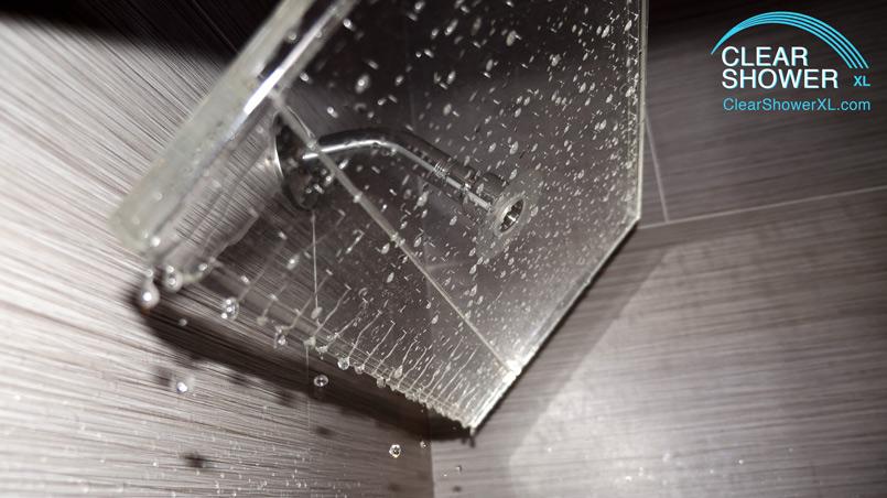 clear waterfall showerhead in grey bathroom