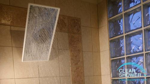rain showerhead in beige bathroom