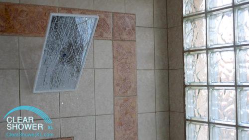 Mirror showerhead in beige bathroom